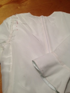 Had stitching  on the lining. Yep- can be done by machine, but what else would I do watching TV?  Ok, call me crazy. But  I like investing hand sewing into the garment.